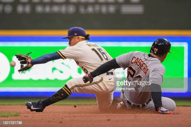 Kolten Wong of the Milwaukee Brewers gets the force out at second base in the fourth inning against Miguel Cabrera of the Detroit Tigers at American...