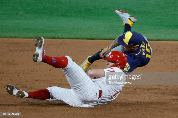 Kolten Wong of the Milwaukee Brewers tags Rhys Hoskins of the Philadelphia Phillies during the third inning at Citizens Bank Park on May 04, 2021 in...