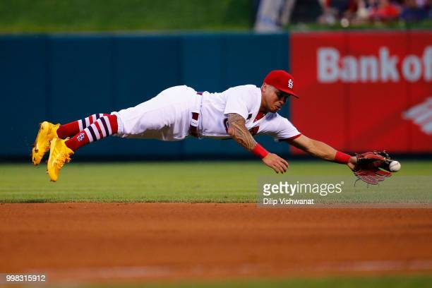 Kolten Wong of the St Louis Cardinals attempts to catch a line drive against the Cincinnati Reds in the third inning at Busch Stadium on July 13 2018...