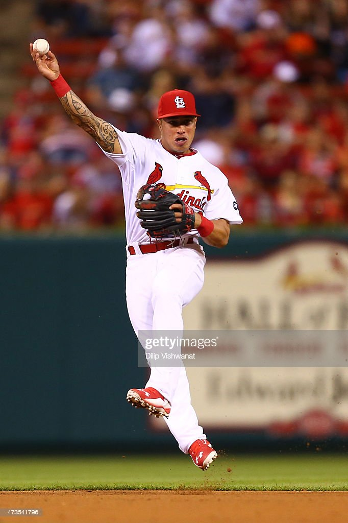 Kolten Wong #16 of the St. Louis Cardinals attempts to throw a runner out at first base against the Detroit Tigers in the eighth inning at Busch Stadium on May 15, 2015 in St. Louis, Missouri.