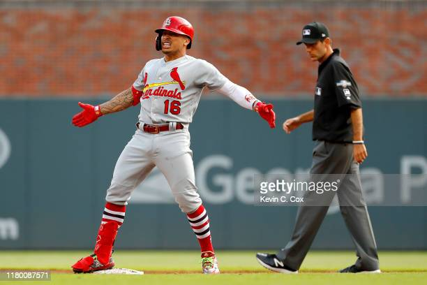 Kolten Wong of the St. Louis Cardinals celebrates after hitting a two-RBI double against the Atlanta Braves during the first inning in game five of...