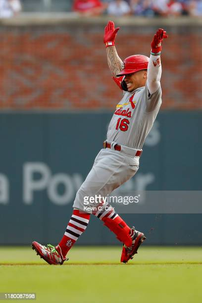 Kolten Wong of the St Louis Cardinals celebrates after hitting a twoRBI double against the Atlanta Braves during the first inning in game five of the...
