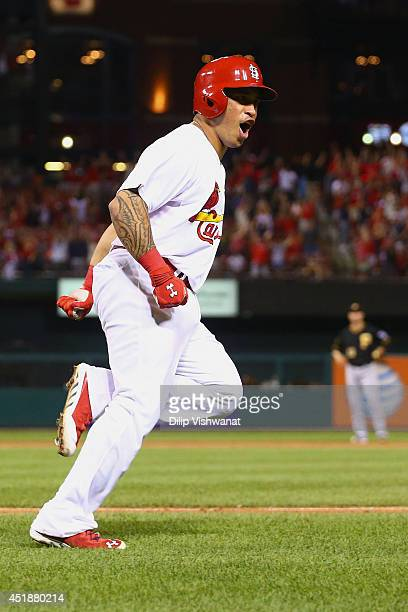 Kolten Wong of the St Louis Cardinals celebrates after hitting a walkoff home run in the ninth inning against the Pittsburgh Pirates at Busch Stadium...