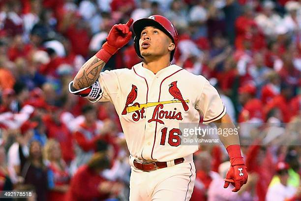 Kolten Wong of the St Louis Cardinals celebrates after hitting a solo home run in the fifth inning against the Chicago Cubs during game two of the...