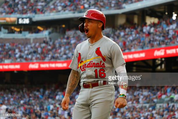 Kolten Wong of the St. Louis Cardinals celebrates after scoring a run on a wild pitch against the Atlanta Braves during the first inning in game five...