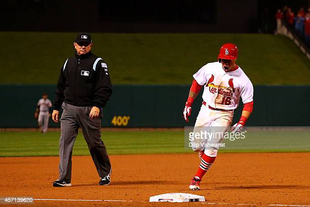 Kolten Wong of the St Louis Cardinals celebrates his solo home run as he rounds the bases in the ninth inning to give the St Louis Cardinals the 5 to...