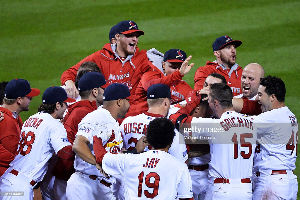 Kolten Wong #16 of the St. Louis Cardinals celebrates his solo home run in the ninth inning to give the St. Louis Cardinals the 5 to 4 win over the San Francisco Giants with teammates during Game Two of the National League Championship Series at Busch Stadium on October 12, 2014 in St Louis, Missouri.