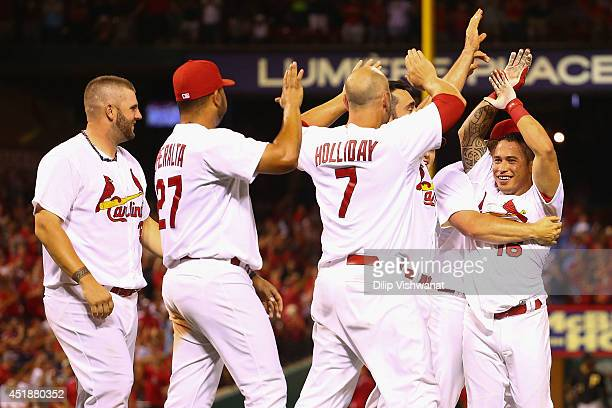 Kolten Wong of the St Louis Cardinals celebrates with his teammates after hitting a walkoff home run in the ninth inning against the Pittsburgh...