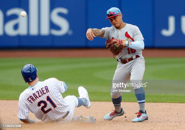 Kolten Wong of the St Louis Cardinals completes a game ending double play after forcing out Todd Frazier of the New York Mets at Citi Field on June...