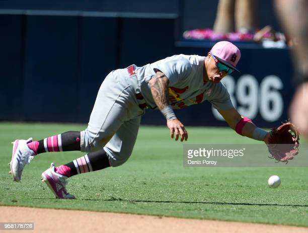 Kolten Wong of the St Louis Cardinals dives but can't make the catch on a single hit by Freddy Galvis of the San Diego Padres during the fifth inning...