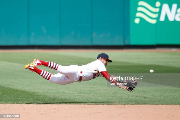 Kolten Wong of the St Louis Cardinals dives for a ball in the sixth inning of a game against the Philadelphia Phillies at Busch Stadium on June 11...