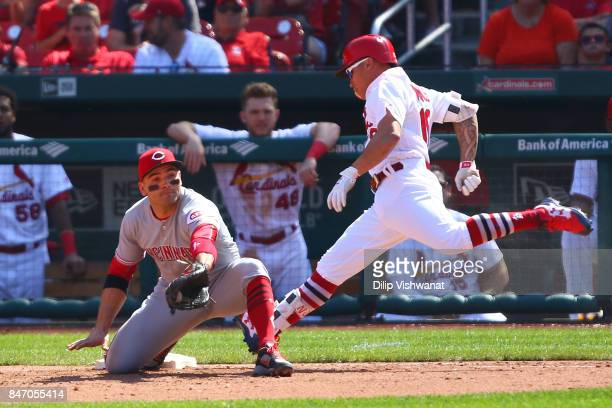 Kolten Wong of the St Louis Cardinals fails to beat the throw to Joey Votto of the Cincinnati Reds for an out at first base in the sixth inning at...