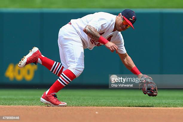 Kolten Wong of the St Louis Cardinals fields a ground ball against the San Diego Padres in the first inning at Busch Stadium on July 5 2015 in St...