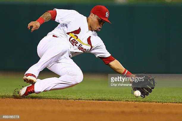 Kolten Wong of the St Louis Cardinals fields a ground ball in the eighth inning against the Kansas City Royals at Busch Stadium on June 3 2014 in St...