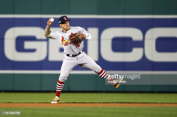 Kolten Wong of the St. Louis Cardinals fields the ball for an out on Trea Turner of the Washington Nationals during the first inning of game three of...