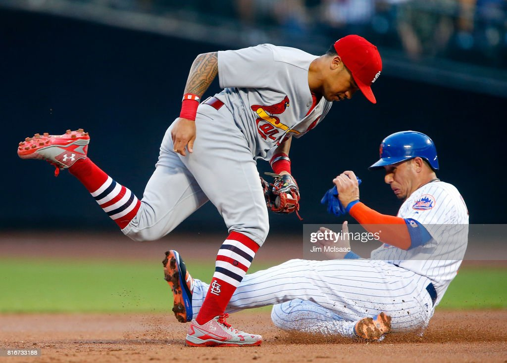 Kolten Wong #16 of the St. Louis Cardinals gets a force out at second base in the first inning against Asdrubal Cabrera #13 of the New York Mets on July 17, 2017 at Citi Field in the Flushing neighborhood of the Queens borough of New York City.