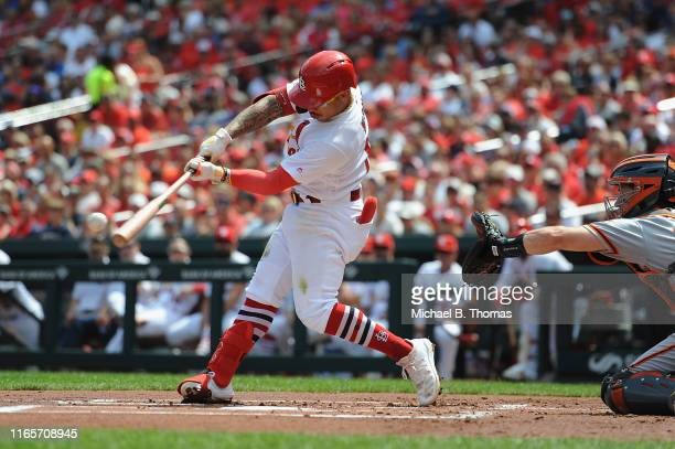 Kolten Wong of the St Louis Cardinals hits a RBI triple in the first inning against the San Francisco Giants at Busch Stadium on September 2 2019 in...