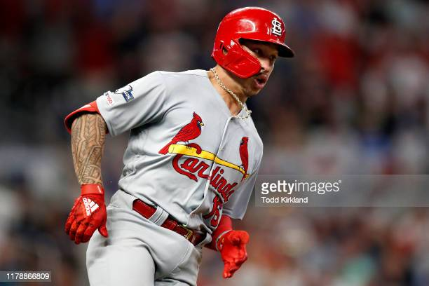 Kolten Wong of the St Louis Cardinals hits a twoRBI double against the Atlanta Braves during the ninth inning in game one of the National League...
