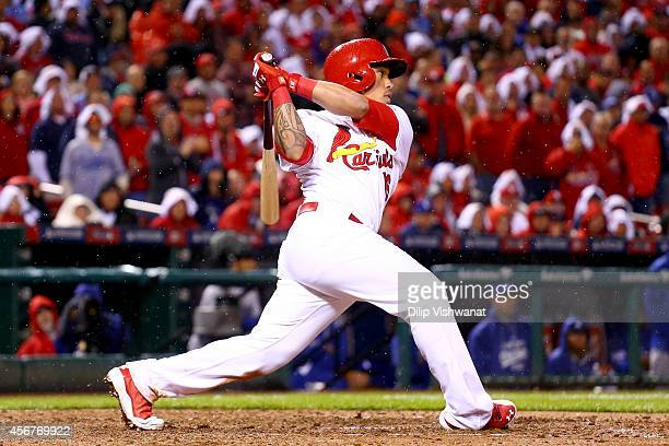 Kolten Wong of the St. Louis Cardinals hits a two-run home run in the seventh inning against the Los Angeles Dodgers in Game Three of the National...