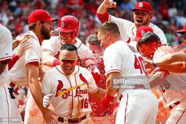 Kolten Wong of the St Louis Cardinals is mobbed by his teammates after hitting a walkoff home run against the Pittsburgh Pirates in the ninth inning...