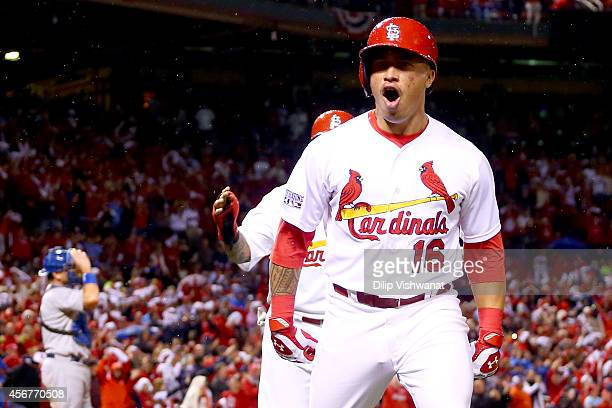 Kolten Wong of the St. Louis Cardinals reacts after he hits a two-run home run in the seventh inning against the Los Angeles Dodgers in Game Three of...