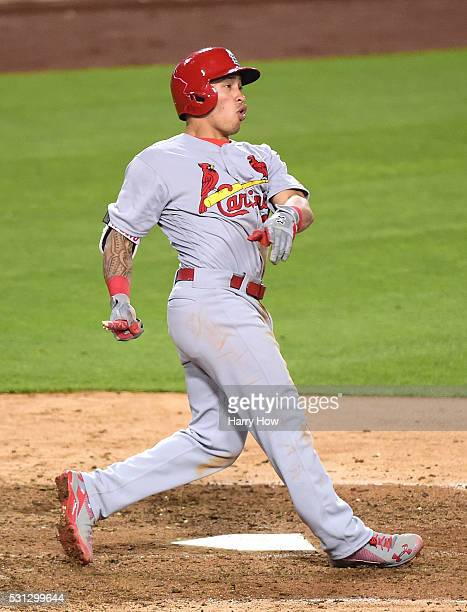 Kolten Wong of the St Louis Cardinals reacts to his broken bat triple during the sixth inning against the Los Angeles Dodgers at Dodger Stadium on...