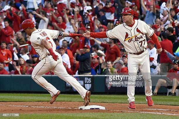 Kolten Wong of the St Louis Cardinals runs the bases after hitting a solo home run in the fifth inning against the Chicago Cubs during game two of...