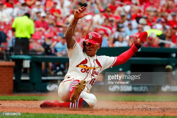 Kolten Wong of the St Louis Cardinals scores a run against the Cincinnati Reds in the fourth inning during game one of a doubleheader at Busch...