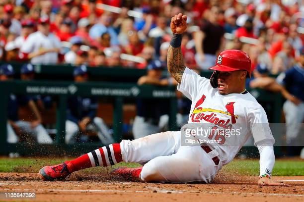 Kolten Wong of the St Louis Cardinals scores a run against the San Diego Padres in the seventh inning at Busch Stadium on April 7 2019 in St Louis...
