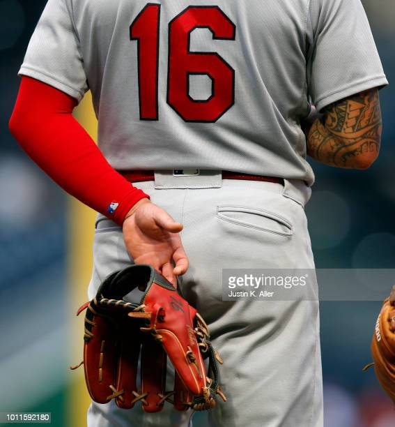 Kolten Wong of the St Louis Cardinals stands during the seventh inning stretch in a game against against the Pittsburgh Pirates at PNC Park on August...