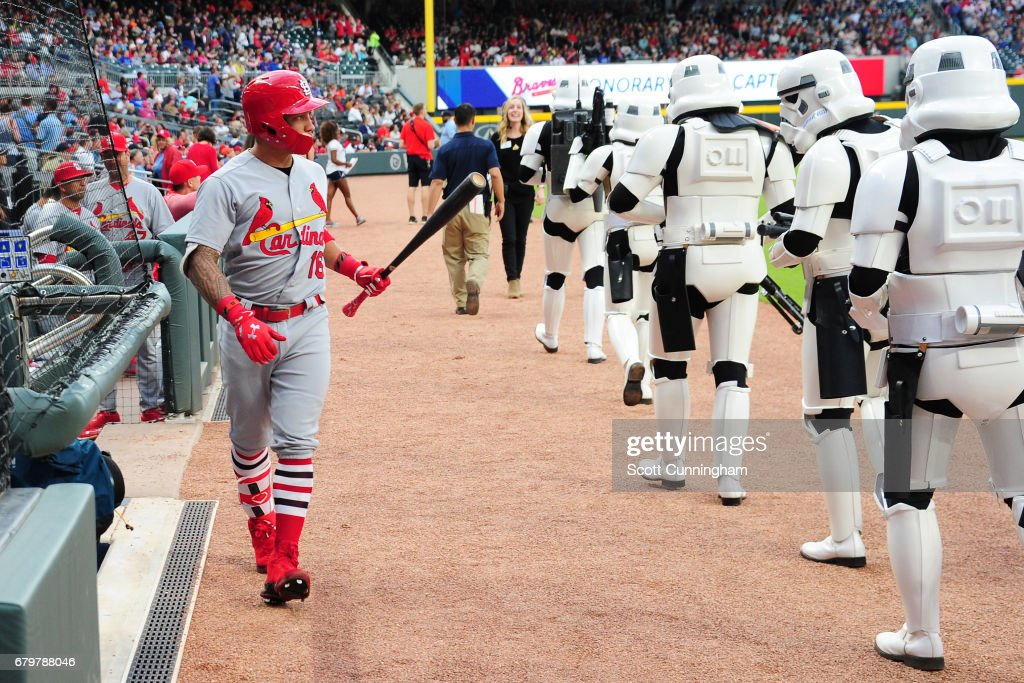 Kolten Wong #16 of the St. Louis Cardinals threatens a StormTrooper as he heads to the on deck circle to start the game against the Atlanta Braves at SunTrust Park on May 6, 2017 in Atlanta, Georgia.