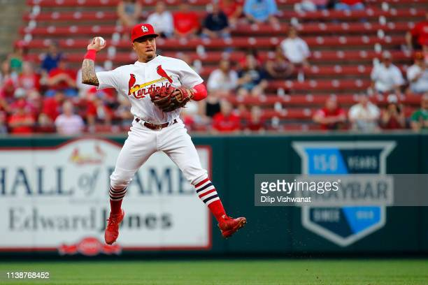 Kolten Wong of the St Louis Cardinals throws to first base against the Milwaukee Brewers in the first inning at Busch Stadium on April 22 2019 in St...