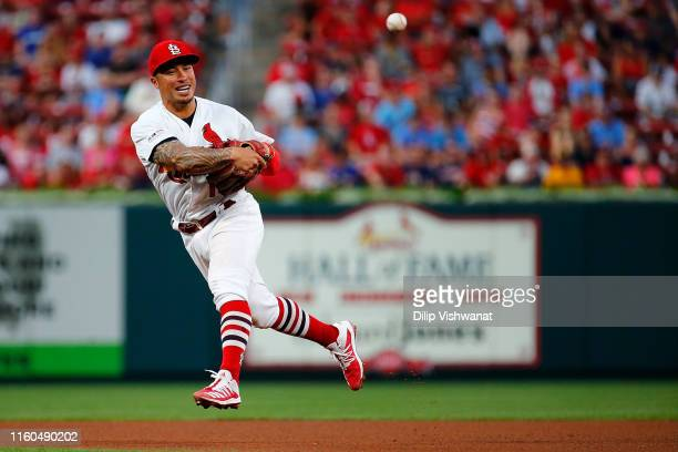 Kolten Wong of the St Louis Cardinals throws to first base against the Pittsburgh Pirates in the third inning at Busch Stadium on August 9 2019 in St...
