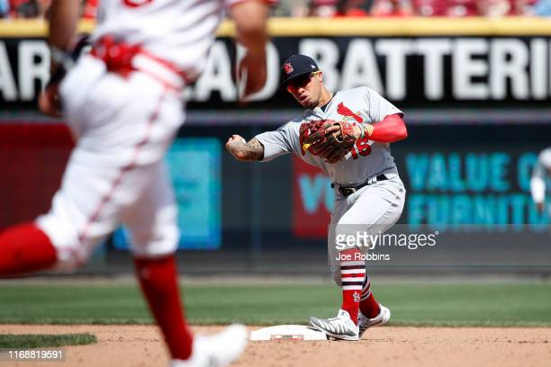 Kolten Wong of the St Louis Cardinals throws to first to turn a double play with the bases loaded in the seventh inning against the Cincinnati Reds...