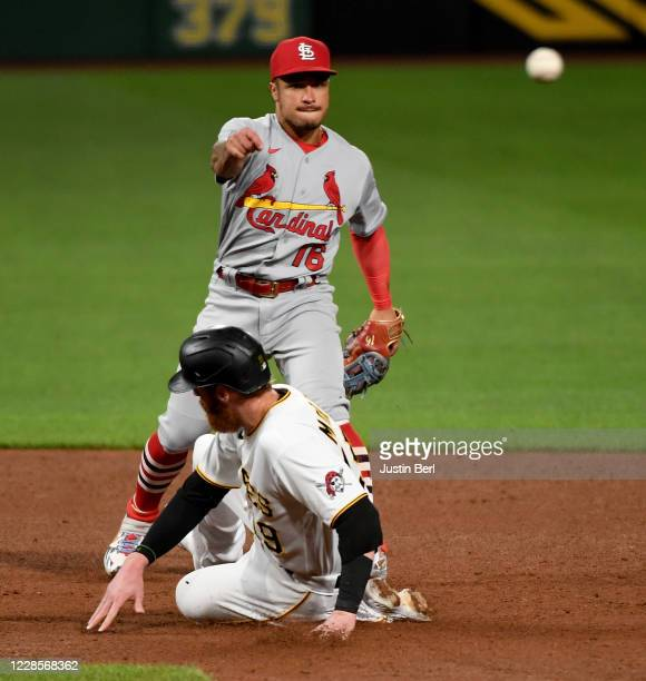 Kolten Wong of the St. Louis Cardinals turns a double play against Colin Moran of the Pittsburgh Pirates in the fifth inning during the game at PNC...