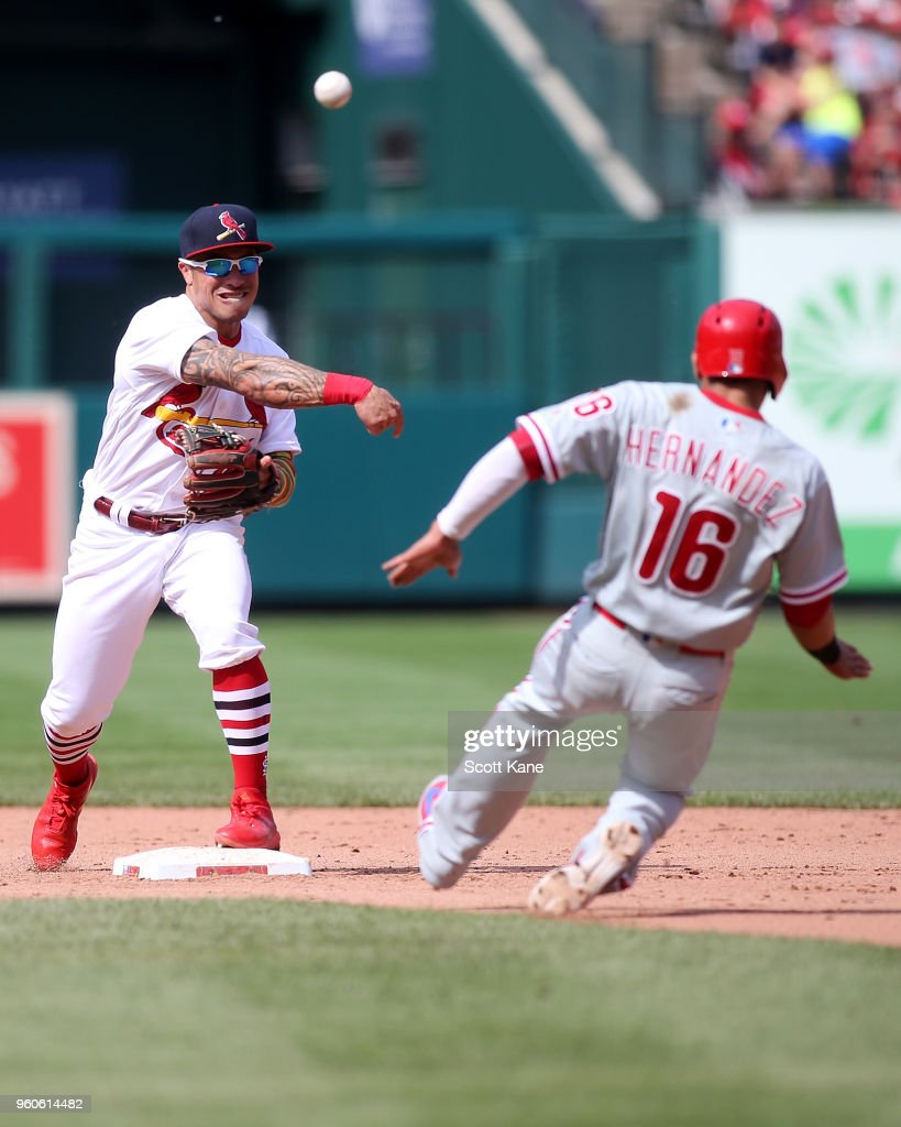 Kolten Wong #16 of the St. Louis Cardinals turns a double play over Cesar Hernandez #16 of the Philadelphia Phillies during the ninth inning at Busch Stadium on May 20, 2018 in St. Louis, Missouri.