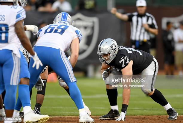 Kolton Miller of the Oakland Raiders lins up in front of Anthony Zettel of the Detroit Lions during the first quarter of their NFL preseason football...