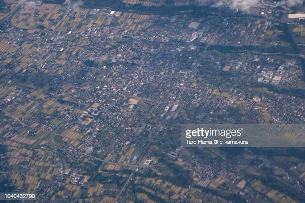 Komagane city in Nagano prefecture in Japan daytime aerial view from airplane