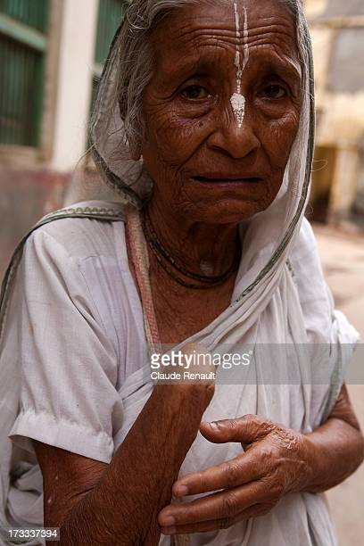 Komala, a widow from West Bengal near the Sri Bhajan Ashram in Vrindavan. She was coming out of the Ashram and complaining about her arm hurting her.