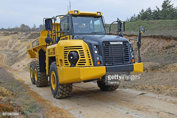 komatsu hm300 on the road - modern essentials by h&m stock pictures, royalty-free photos & images