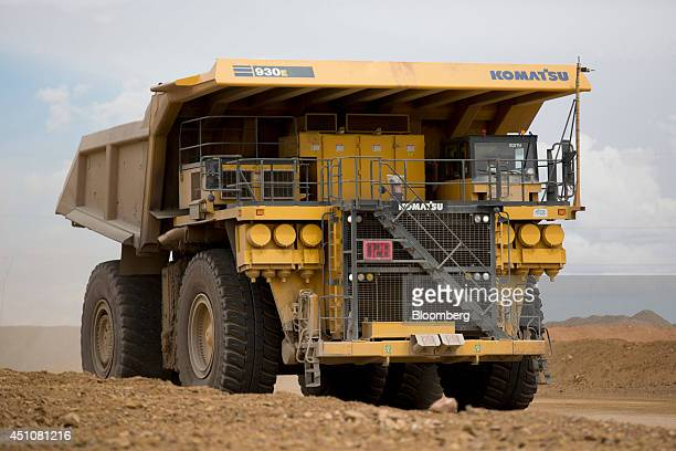 Komatsu Ltd. 930E dump truck drives outside an open pit at the Oyu Tolgoi copper-gold mine, jointly owned by Rio Tinto Group's Turquoise Hill...