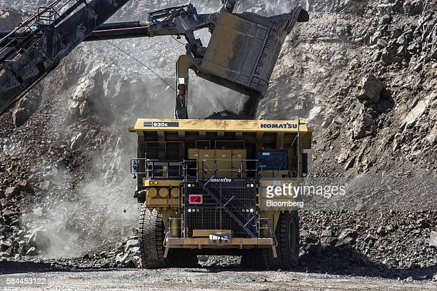 A Komatsu Ltd dump truck is loaded with ore in an open pit at the Oyu Tolgoi coppergold mine jointly owned by Rio Tinto Group's Turquoise Hill...