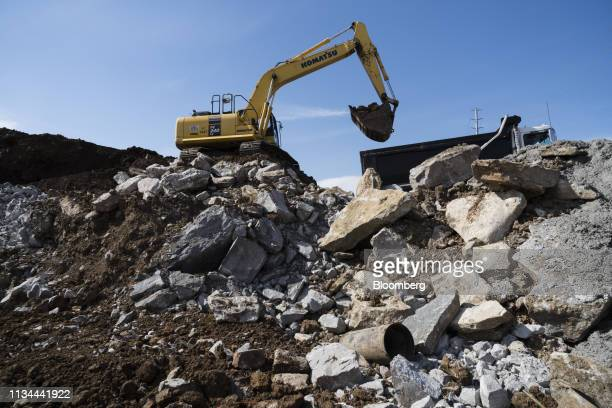 Komatsu Ltd. Excavator loads debris into a truck at the construction site of the Amazon.com Inc. Operations Center of Excellence at the Nashville...