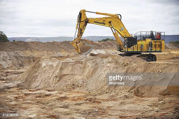 A Komatsu Ltd excavator moves sand in a pit at the MZI Resources Ltd Keysbrook mineral sands mine in Keysbrook near Perth Australia on Monday April 4...
