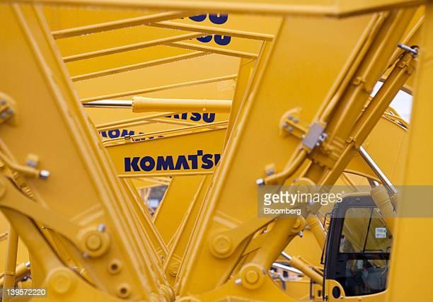 Komatsu Ltd. Excavators bound for shipment sit at the company's plant in Hirakata City, Osaka, Japan, on Thursday, Feb. 23, 2012. Komatsu Ltd. Is the...