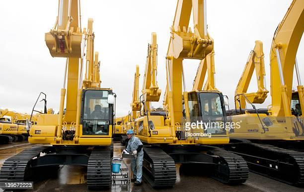 Komatsu Ltd excavators bound for shipment sit at the company's plant in Hirakata City Osaka Japan on Thursday Feb 23 2012 Komatsu Ltd is the world's...