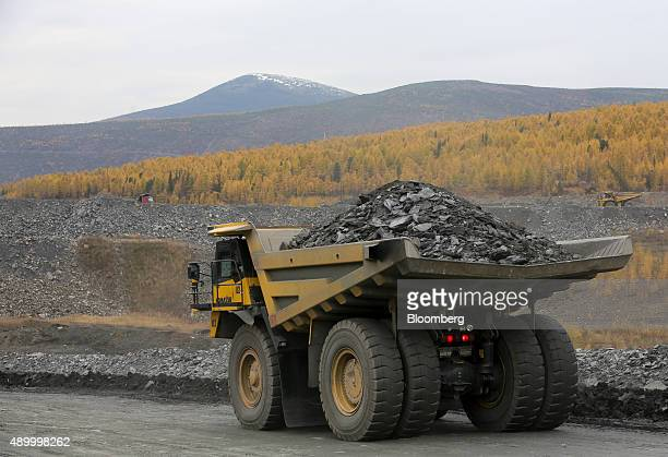 A Komatsu Ltd truck carries rock ore excavated from the open pit at the Verninsky GOK gold mine and processing plant operated by Polyus Gold...