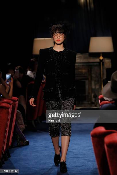 Komatsu Nana showcases designs by CHANEL on the runway during the CHANEL Metiers D'art Collection Paris Cosmopolite show at the Tsunamachi Mitsui...