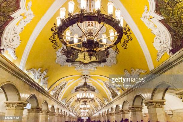 komsomolskya station. ornate yellow painted ceiling and lighting;image of the moscow metro, moscow, russia. september - moscow metro stock pictures, royalty-free photos & images