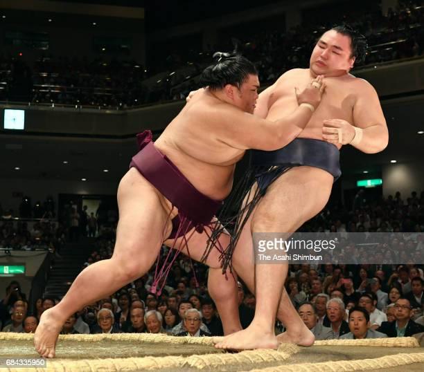 Komusubi Mitakeumi pushes Mongolian yokozuna Kakuryu out of the ring to win during day one of the Grand Sumo Summer Tournament at Ryogoku Kokugikan...